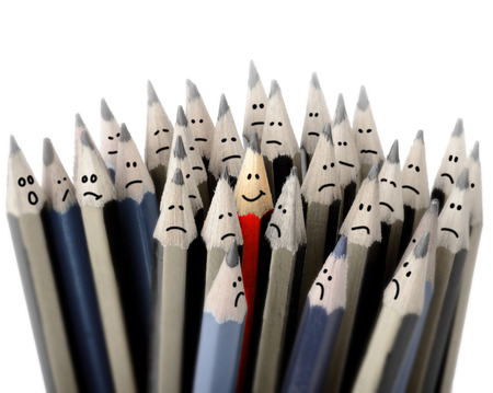 emotional stress: Concept of standing out in a crowd, one happy smile Stock Photo