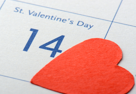 calendar page: Calendar page with the red heart on February 14 of Saint Valentines day. Stock Photo