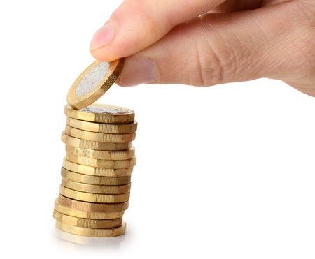 taking a coin from the stack, isolated on a white background Stock Photo