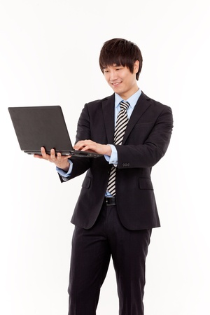 Young business man with laptop   photo