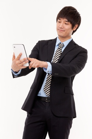 Businessman with tablet PC Stock Photo - 13629438