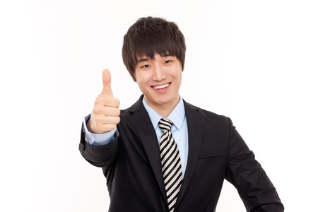 Young business man showing thumb photo