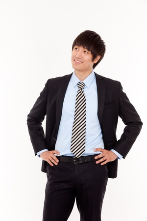 Smiling young businessman look something  photo