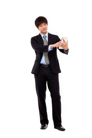 Businessman with tablet PC photo