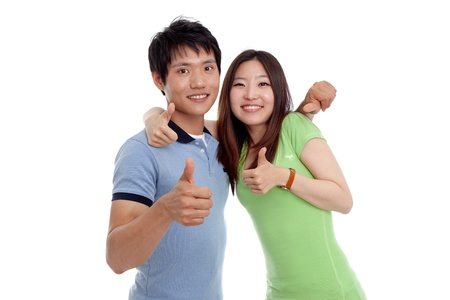 Young smiling people with thumbs up gesture on white background photo
