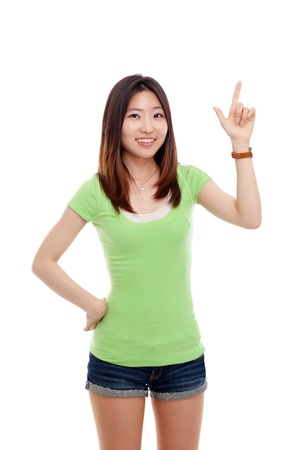 woman pointing up: Smiling Asian woman pointing up isolated on white background Stock Photo