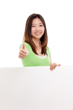 pretty Asian woman holding a panel and show thumb photo