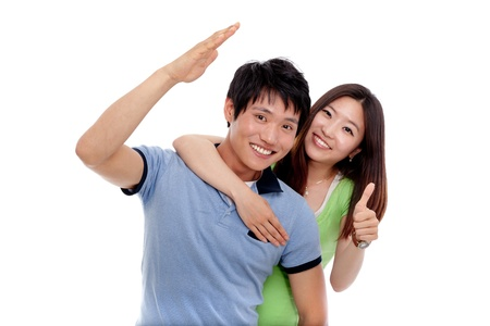 portrait young girl studio: Happy young Asian couple isolated on white background