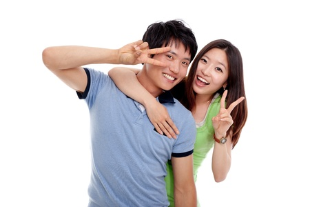 Happy young Asian couple isolated on white background  Stock Photo - 14432607