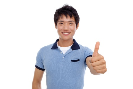 Happy smiling young Asian man show thumb isolated on white background