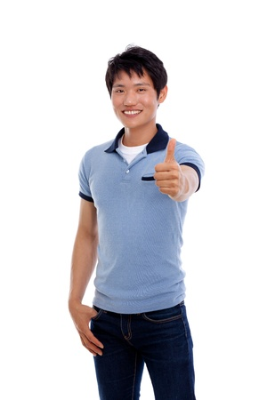 Happy smiling young Asian man show thumb isolated on white background  photo