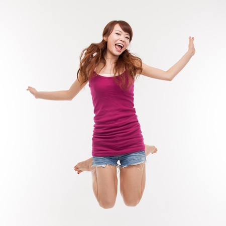 energetic: Jumping happy asian woman Stock Photo