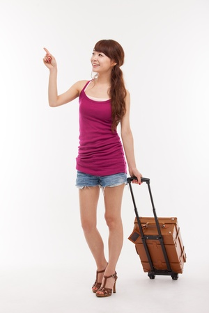 young woman walking with luggage isolated over white 스톡 콘텐츠