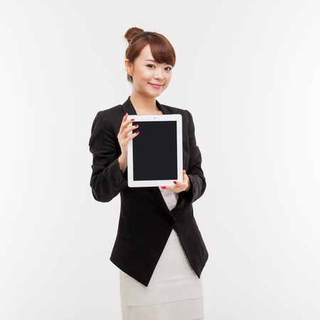 Business woman show empty space of pad PC photo