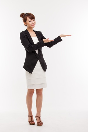 Asian business woman indicate blank space isolated photo