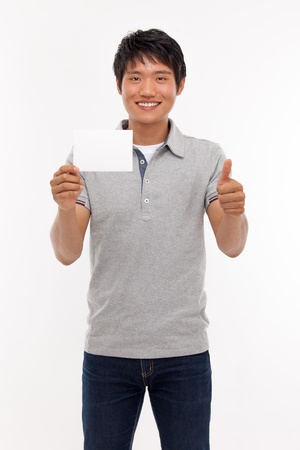 Young man smiling and showing empty card  photo