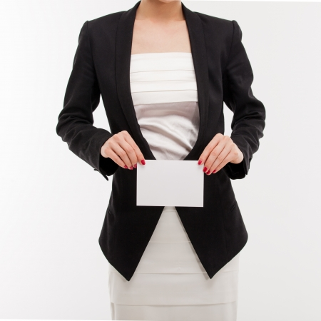 Woman in a business suit holding a blank card for your message  photo