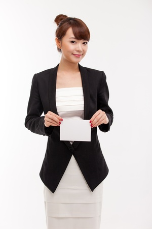 Business woman showing blank card  isolated over white photo
