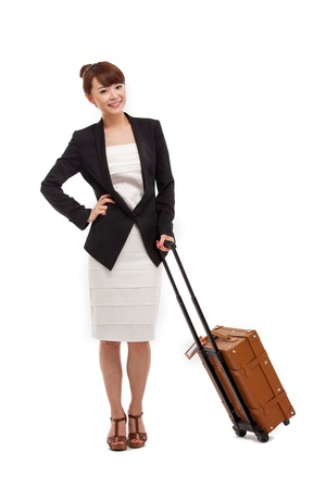 Cheerful businesswomen with travel bag photo