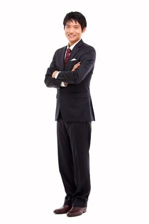 full suit: Young Asian business man isolated on white background