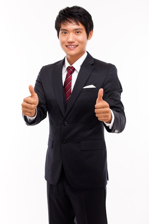 Showing thumb young Asian business man  photo