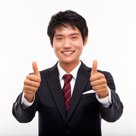 great suit: Showing thumb young Asian business man