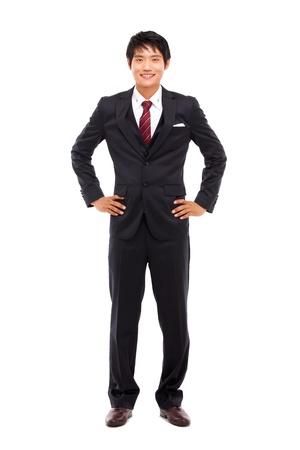 completo: Hombre de negocios joven asi�tica aislada sobre fondo blanco