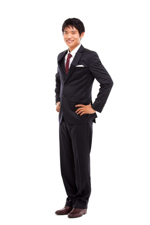 standing man: Young Asian business man isolated on white background
