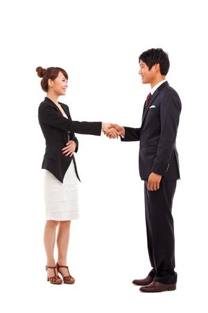 Business couple shaking isolated on white background
