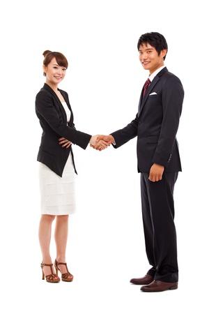 Business couple shaking isolated on white background Stock Photo - 15340377