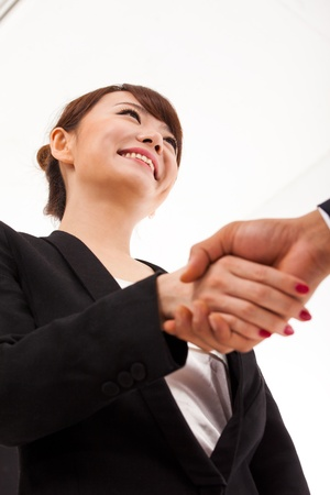 Business woman shaking with someone  Stock Photo