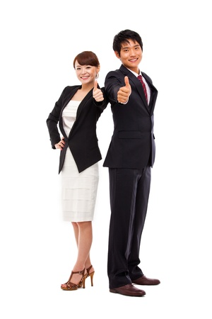 Business couple showing thumb