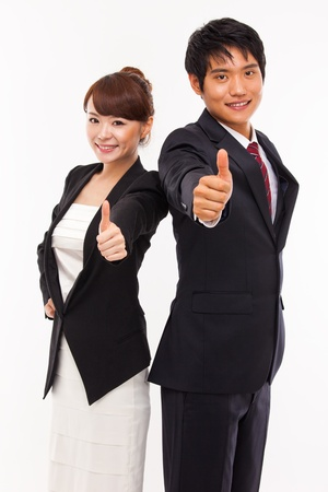 Business couple showing thumb  photo