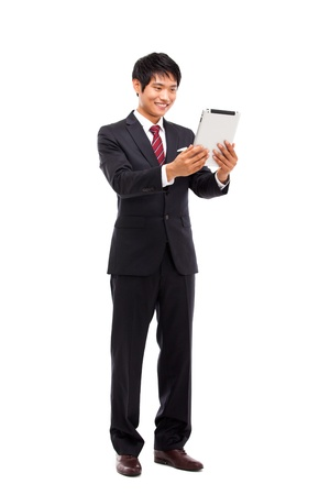 touch pad: Using pad PC business man isolated on white background