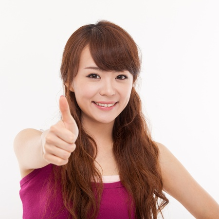woman looking up: Young pretty Asian woman showing thumb