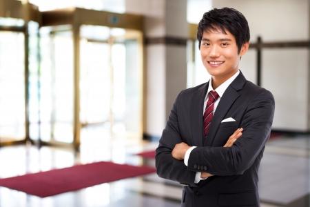 cross arms: Young Asian business man
