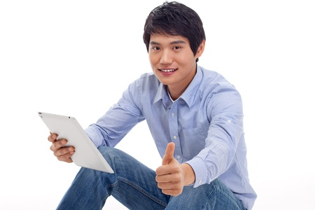 Asian man holding tablet computer isolated on white background Stock Photo - 17121813