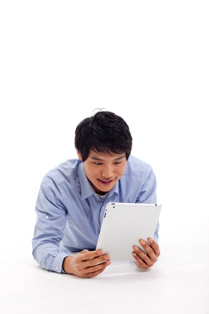 Asian man holding tablet computer isolated on white background Stock Photo - 17125447