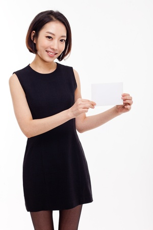 Business woman showing blank card  isolated over white Stock Photo - 17110515