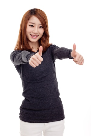 Young Asian woman showing thumb isolated on white background