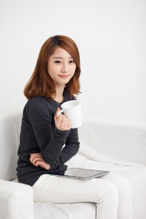 studing: Young Asian woman using a pad PC Stock Photo