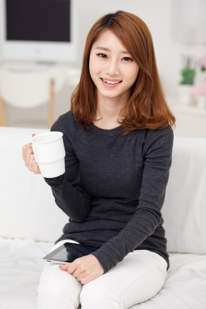 Young Asian woman using a pad PC Stock Photo - 17157980