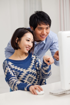 Young Asian couple using PC Stock Photo - 17184662