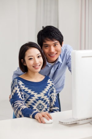 Young Asian couple using PC photo