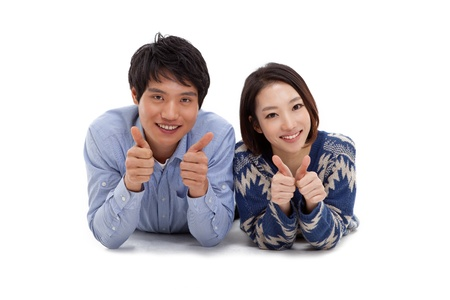 Young Asian couple showing thumbs Stock Photo - 17184657