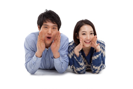 Young Asian couple saying isolated on white background Stock Photo - 17184655