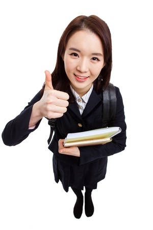 high angle shot: Young Asian student shwoing thumbs and high angle shot  isolated on white background