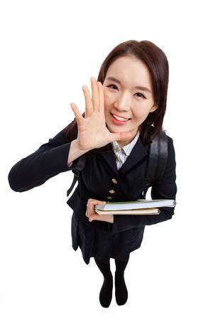 Young Asian student saying something high angle shot  isolated on white background Stock Photo - 17355111