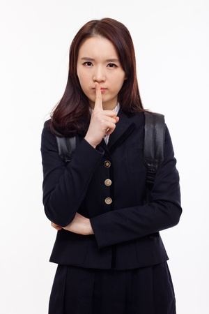 Young Asian student showing calm sign  isolated on white background  photo