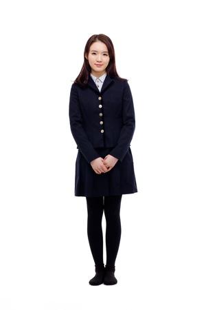 uniform school: Tiro Joven estudiante completo asi�tica aislada sobre fondo blanco.